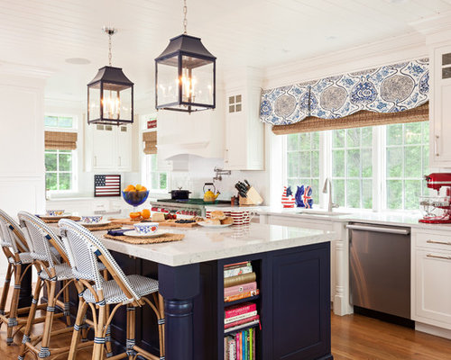 Beach Style Single Wall Kitchen Idea In Boston With White Cabinets, White  Backsplash,