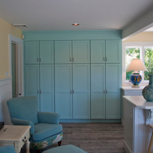 Design ideas for a mid-sized beach style l-shaped eat-in kitchen in Boston with an undermount sink, shaker cabinets, white cabinets, quartz benchtops, blue splashback, mosaic tile splashback, stainless steel appliances, porcelain floors and with island.