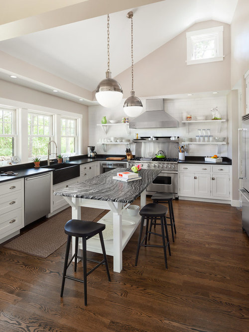 Example of a transitional u-shaped kitchen design in Portland Maine with a  farmhouse sink
