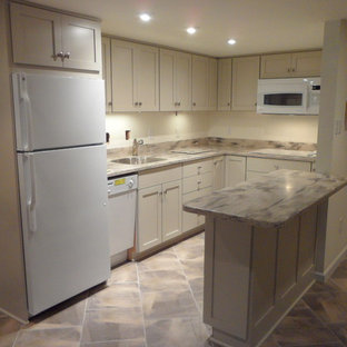 Photo of a transitional u-shaped eat-in kitchen in DC Metro with an undermount sink, shaker cabinets, beige cabinets, solid surface benchtops and white appliances.