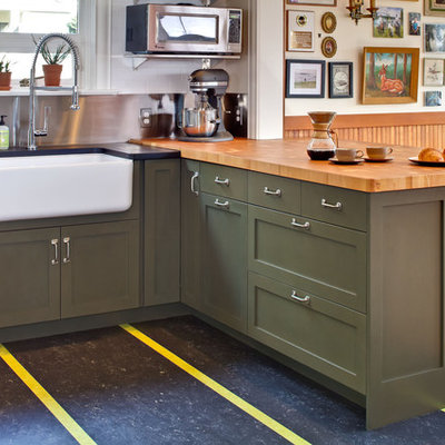 Transitional kitchen photo in Seattle with a farmhouse sink, shaker cabinets, green cabinets and wood countertops