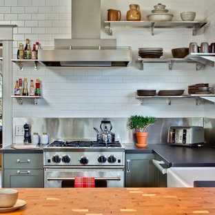 Transitional kitchen photos - Kitchen - transitional u-shaped kitchen idea in Seattle with a farmhouse sink, stainless steel appliances, green cabinets, white backsplash and subway tile backsplash