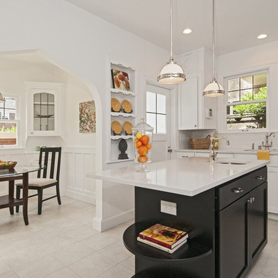 Eat-in kitchen - traditional eat-in kitchen idea in Seattle with an undermount sink, white cabinets, white backsplash, subway tile backsplash and stainless steel appliances