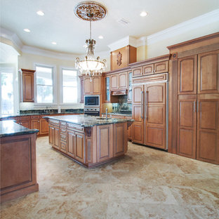Large traditional eat-in kitchen ideas - Eat-in kitchen - large traditional u-shaped marble floor eat-in kitchen idea in Other with an island