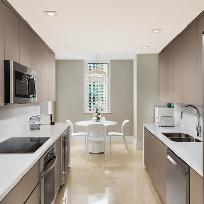 Small trendy marble floor and beige floor kitchen photo in Miami with flat-panel cabinets, brown cabinets, quartzite countertops, white backsplash, quartz backsplash, no island and white countertops