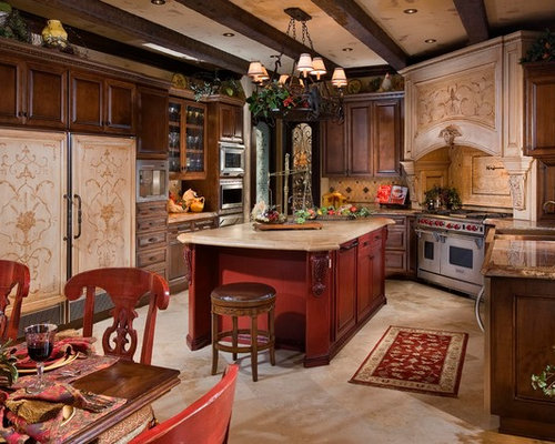 inspiration for a mediterranean kitchen remodel in orange county with raised panel cabinets dark - Old World Style Kitchens