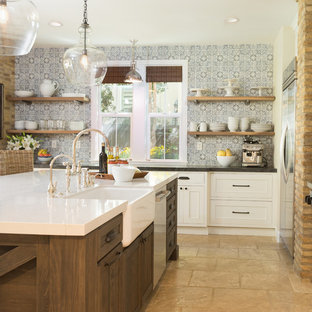 This is an example of a large country u-shaped open plan kitchen in San Diego with a farmhouse sink, recessed-panel cabinets, white cabinets, quartzite benchtops, blue splashback, cement tile splashback, stainless steel appliances, travertine floors, with island and beige floor.