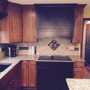 Mid-sized arts and crafts u-shaped eat-in kitchen in Indianapolis with an undermount sink, recessed-panel cabinets, medium wood cabinets, quartz benchtops, metallic splashback, ceramic splashback, stainless steel appliances, ceramic floors and with island.