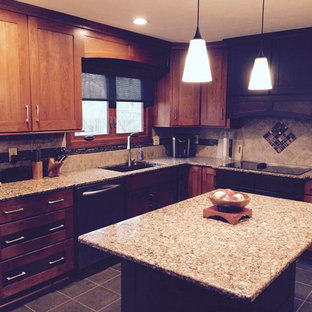 Photo of a mid-sized arts and crafts u-shaped eat-in kitchen in Indianapolis with an undermount sink, recessed-panel cabinets, medium wood cabinets, quartz benchtops, metallic splashback, ceramic splashback, stainless steel appliances, ceramic floors and with island.