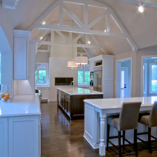 Carmel White Kitchen Renovation with Vaulted and Beamed Ceiling