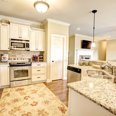 Traditional Kitchen by The Pugh Group New Home Division