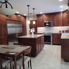 Transitional Kitchen by Tinkermen's Construction, Inc.