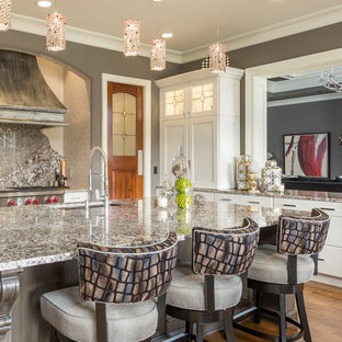 Traditional kitchen pictures - Kitchen - traditional kitchen idea in Raleigh with an undermount sink, recessed-panel cabinets, white cabinets, gray backsplash, stone slab backsplash, stainless steel appliances and an island