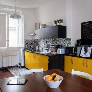 Inspiration for a mid-sized contemporary single-wall eat-in kitchen in Rome with a drop-in sink, flat-panel cabinets, yellow cabinets, dark hardwood floors and porcelain splashback.