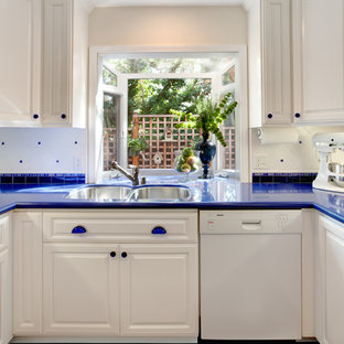 This is an example of a traditional kitchen in San Francisco with white appliances, a double-bowl sink and blue benchtop.