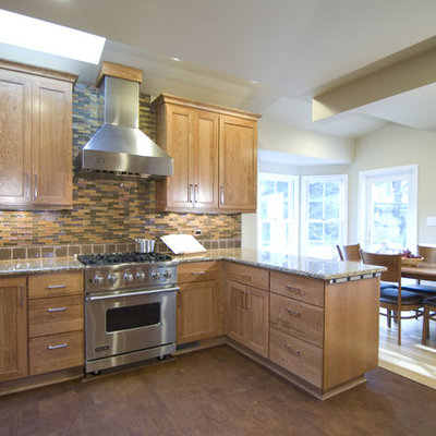 Elegant eat-in kitchen photo in DC Metro with shaker cabinets, medium tone wood cabinets and multicolored backsplash
