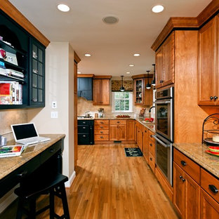 Kitchen - traditional kitchen idea in DC Metro with recessed-panel cabinets, granite countertops, medium tone wood cabinets, beige backsplash, stone tile backsplash and stainless steel appliances