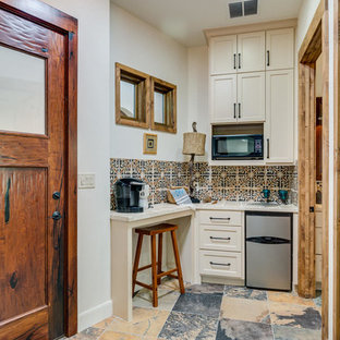 Photo of a small transitional single-wall separate kitchen in Austin with an integrated sink, white cabinets, multi-coloured floor, multi-coloured splashback, stainless steel appliances, shaker cabinets, tile benchtops, porcelain splashback, slate floors and no island.