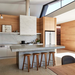 This is an example of a contemporary single-wall eat-in kitchen in Melbourne with flat-panel cabinets, white cabinets, grey splashback, white appliances, with island and grey benchtop.