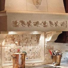Mediterranean Kitchen by Limestone mantels and stone kitchen  hoods