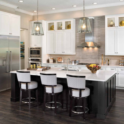 Inspiration for a large transitional l-shaped dark wood floor and brown floor eat-in kitchen remodel in San Diego with an undermount sink, shaker cabinets, stainless steel appliances, an island, solid surface countertops, beige backsplash and stone tile backsplash