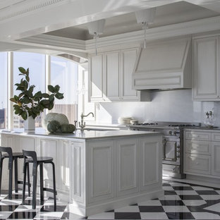 Inspiration for a large traditional galley separate kitchen in San Francisco with white cabinets, white splashback, with island, multi-coloured floor, an undermount sink, beaded inset cabinets, marble benchtops and porcelain floors.