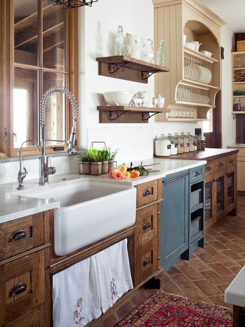 Large Farmhouse Kitchen Designs   Inspiration For A Large Farmhouse  Terra Cotta Floor Kitchen Remodel