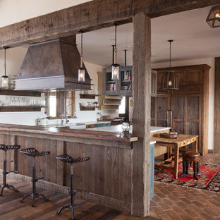 Large farmhouse eat-in kitchen ideas - Inspiration for a large country u-shaped eat-in kitchen remodel in Denver with a farmhouse sink, shaker cabinets, distressed cabinets, white backsplash, ceramic backsplash and an island