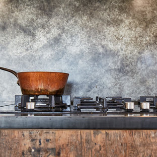 Inspiration for a large industrial open plan kitchen in Other with an undermount sink, flat-panel cabinets, medium wood cabinets, zinc benchtops, grey splashback, stainless steel appliances, concrete floors, a peninsula, grey floor and grey benchtop.