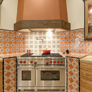 Large southwestern kitchen remodeling - Kitchen - large southwestern u-shaped kitchen idea in Phoenix with medium tone wood cabinets, granite countertops, multicolored backsplash, stainless steel appliances, an island and beige countertops