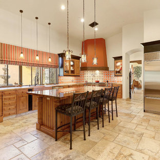 Large southwestern kitchen designs - Kitchen - large southwestern u-shaped beige floor kitchen idea in Phoenix with medium tone wood cabinets, granite countertops, multicolored backsplash, stainless steel appliances, an island, beige countertops and a farmhouse sink