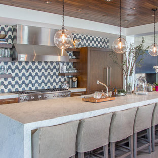 Contemporary open concept kitchen pictures - Open concept kitchen - contemporary open concept kitchen idea in Seattle with open cabinets, multicolored backsplash, stainless steel appliances and an island