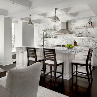 Example of a transitional dark wood floor kitchen design in Chicago with raised-panel cabinets, white cabinets, marble countertops, white backsplash, stone slab backsplash and an island