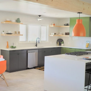 1960s u-shaped beige floor eat-in kitchen photo in Other with an undermount sink, flat-panel cabinets, green cabinets, white backsplash, subway tile backsplash, stainless steel appliances, an island and white countertops