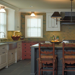 Country kitchen in Minneapolis with a farmhouse sink, slate floors and slate splashback.