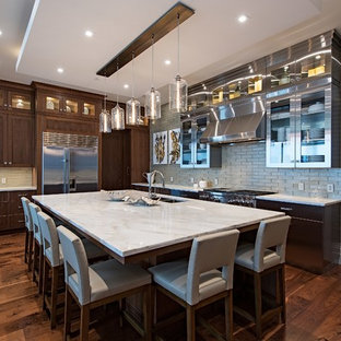 Contemporary kitchen appliance - Kitchen - contemporary l-shaped dark wood floor and brown floor kitchen idea in Kansas City with an undermount sink, shaker cabinets, dark wood cabinets, gray backsplash, glass tile backsplash, stainless steel appliances, an island and white countertops