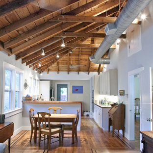Example of a classic eat-in kitchen design in Charleston with white cabinets and wood countertops