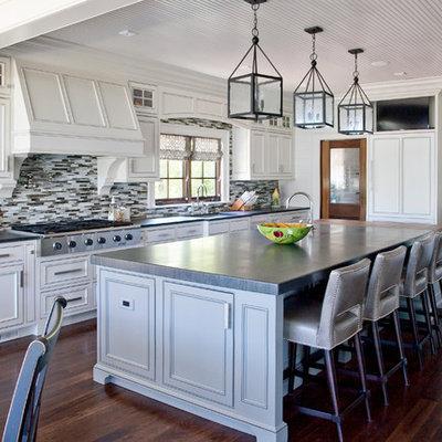 Elegant kitchen photo in Charleston with matchstick tile backsplash, multicolored backsplash, paneled appliances, beaded inset cabinets and white cabinets