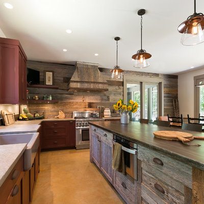 Inspiration for a rustic l-shaped eat-in kitchen remodel in Charleston with a farmhouse sink, shaker cabinets, stainless steel appliances, an island and dark wood cabinets