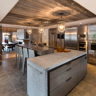 Inspiration for a rustic l-shaped kitchen with flat-panel cabinets, medium wood cabinets, stainless steel appliances, an island, grey floors, grey worktops and a wood ceiling.