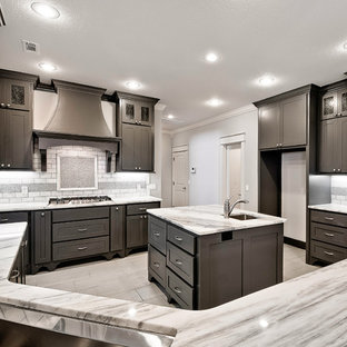 Large transitional kitchen appliance - Example of a large transitional u-shaped gray floor and marble floor kitchen design in Other with shaker cabinets, dark wood cabinets, marble countertops, white backsplash, stone tile backsplash, stainless steel appliances, an island and an undermount sink