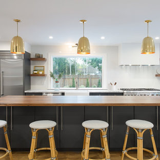 Mid-sized contemporary eat-in kitchen inspiration - Eat-in kitchen - mid-sized contemporary galley light wood floor eat-in kitchen idea in Salt Lake City with a farmhouse sink, flat-panel cabinets, blue cabinets, quartz countertops, white backsplash, ceramic backsplash, stainless steel appliances and an island