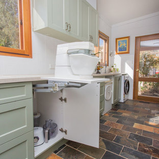 Photo of a small country galley kitchen in Other with a double-bowl sink, shaker cabinets, green cabinets, solid surface benchtops, white splashback, metal splashback, slate floors, multi-coloured floor and beige benchtop.