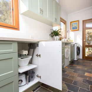 Inspiration for a small country galley kitchen in Other with a double-bowl sink, shaker cabinets, green cabinets, solid surface benchtops, white splashback, metal splashback, slate floors, multi-coloured floor and beige benchtop.