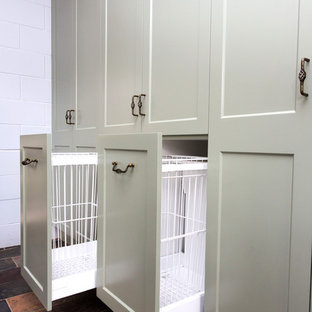 This is an example of a small country galley kitchen in Other with a double-bowl sink, shaker cabinets, green cabinets, solid surface benchtops, white splashback, metal splashback, slate floors, multi-coloured floor and beige benchtop.
