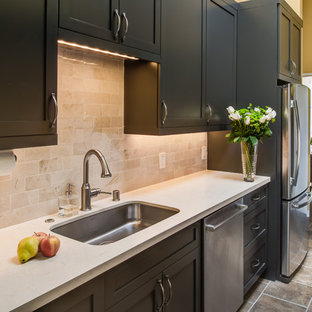 Small modern galley kitchen pantry in San Francisco with a single-bowl sink, shaker cabinets, grey cabinets, engineered stone countertops, beige splashback, porcelain splashback, stainless steel appliances, porcelain flooring and no island.