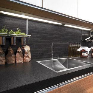 Inspiration for a mid-sized contemporary galley porcelain floor eat-in kitchen remodel in Brisbane with black backsplash and stainless steel appliances