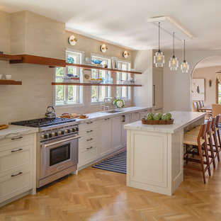 Transitional kitchen ideas - Example of a transitional light wood floor kitchen design in San Francisco with an undermount sink, open cabinets, window backsplash, stainless steel appliances and an island