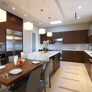Photo of a mid-sized modern l-shaped open plan kitchen in Vancouver with a double-bowl sink, flat-panel cabinets, dark wood cabinets, marble benchtops, grey splashback, stainless steel appliances, ceramic floors, multiple islands and glass sheet splashback.