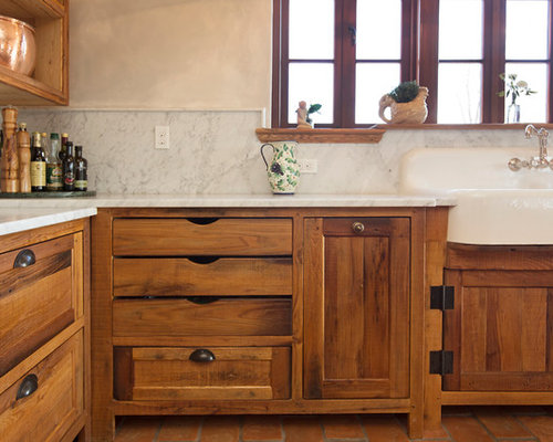 Example Of A Country L Shaped Kitchen Design In Nashville With A Farmhouse  Sink,